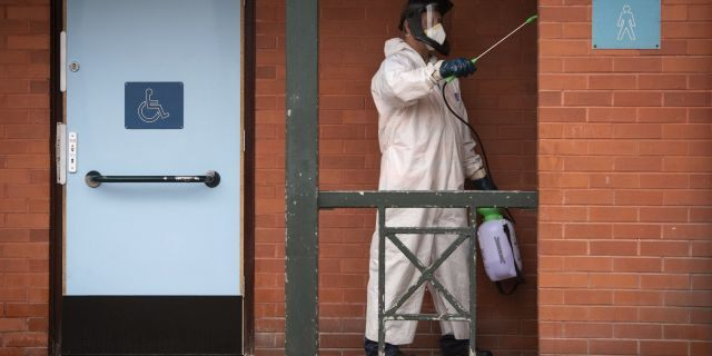 A man disinfects public toilets in Leicester on Monday. (AP/PA)