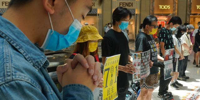 Protesters gather at a shopping mall during a pro-democracy protest against Beijing's national security law in Hong Kong on Tuesday. (AP)