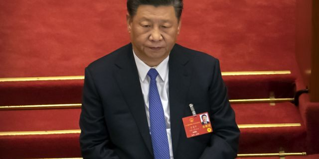 Chinese President Xi Jinping attends the closing session of China's National People's Congress (NPC) in Beijing, Thursday, May 28, 2020. China's ceremonial legislature has endorsed a national security law for Hong Kong that has strained relations with the United States and Britain.