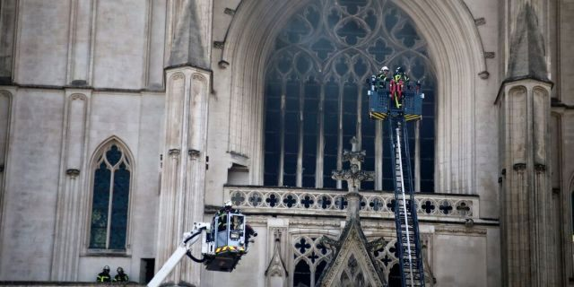 The fire shattered stained glass windows and sent black smoke spewing from between its two towers of the 15th-century cathedral, which also suffered a serious fire in 1972.