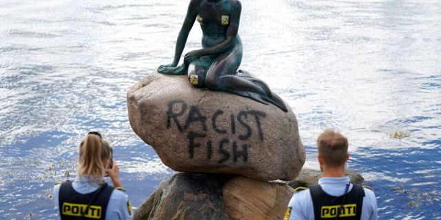 Police stand by the statue of the Little Mermaid, after it was vandalized, in Copenhagen, Denmark, Friday, July 3, 2020.