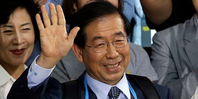 FILE - In this June 5, 2014, file photo, Park Won-soon, then-candidate for Seoul city mayor of the main opposition party New Politics Alliance for Democracy celebrates his victory in the Seoul mayoral election at his office in Seoul, South Korea. (AP Photo/Lee Jin-man, File)