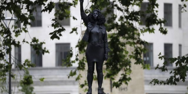 """A new statue entitled """"A Surge of Power (Jen Reid) 2020"""" stands after it was put up this morning on the empty base of the toppled statue of 17th-century slave trader Edward Colston in Bristol, England. (AP)"""