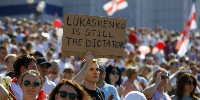 In this Sunday, Aug. 16, 2020 file photo Belarusian opposition supporters rally in the center of Minsk, Belarus. (AP Photo/Sergei Grits, File)