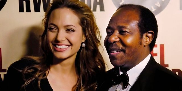 "In this Thursday, Dec. 2, 2004 ,file photo, Paul Rusesabagina, the inspiration for the film ""Hotel Rwanda,"" poses with actress Angelina Jolie at the premiere of the film at the Academy of Motion Picture Arts & Sciences in Beverly Hills, Calif. (AP Photo/Chris Pizzello, File)"
