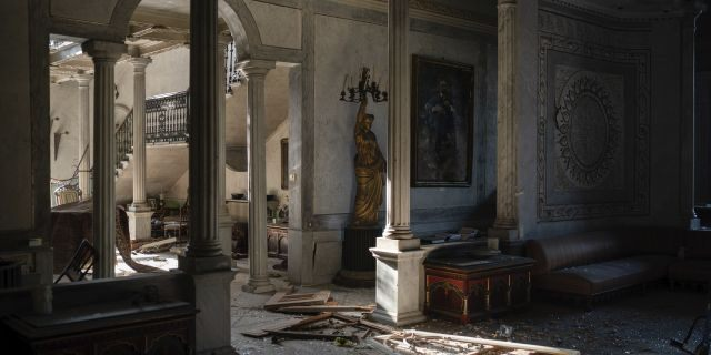 Broken glass and window frames lay on the floor of the Sursock Palace, heavily damaged after the explosion in the seaport of Beirut, Lebanon, on Aug. 7. (AP)