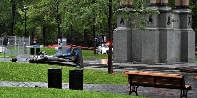 "A statue of the first Canadian Prime Minister John A. Macdonald lies on the ground, with the statue's head a few meters away, at Canada Park in central Montreal on August 29, 2020, after it was pulled down by anti-racism protesters during a demonstration calling for the defunding of the police. - Macdonald's government has been accused of seeking to assimilate indigenous peoples through forcible enrollment in residential schools, for example, that led to a loss of language and culture -- described in a 2015 reconciliation commission report as ""cultural genocide."" (Photo by Eric THOMAS / AFP) (Photo by ERIC THOMAS/AFP via Getty Images)"