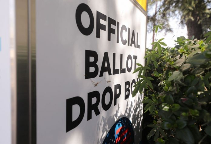 LOS ANGELES, CALIFORNIA - OCTOBER 05:  An official mail-in ballot drop box is posted outside of a library ahead of Election Day on October 5, 2020 in Los Angeles, California. Early voting has begun in California with Los Angeles County posting 400 secure vote-by-mail drop boxes across the county. (Photo by Mario Tama/Getty Images)