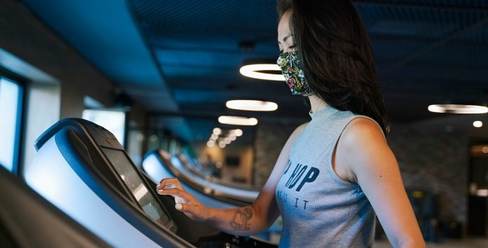 Treadmill, working out, doing cardio, face mask, health club, COVID-19