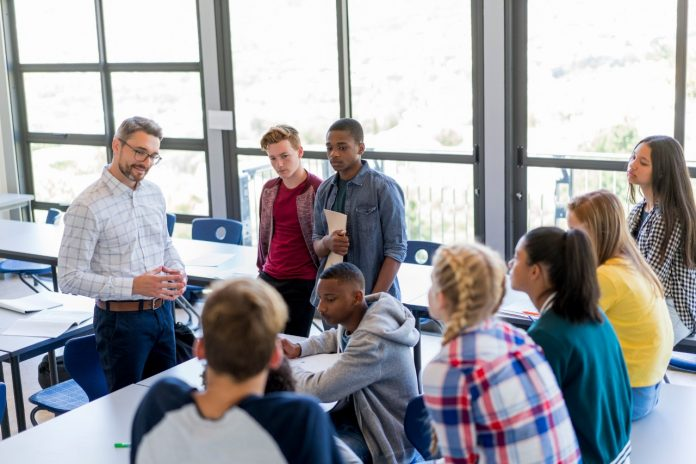 teacher-in-discussion-with-mixed-race-students