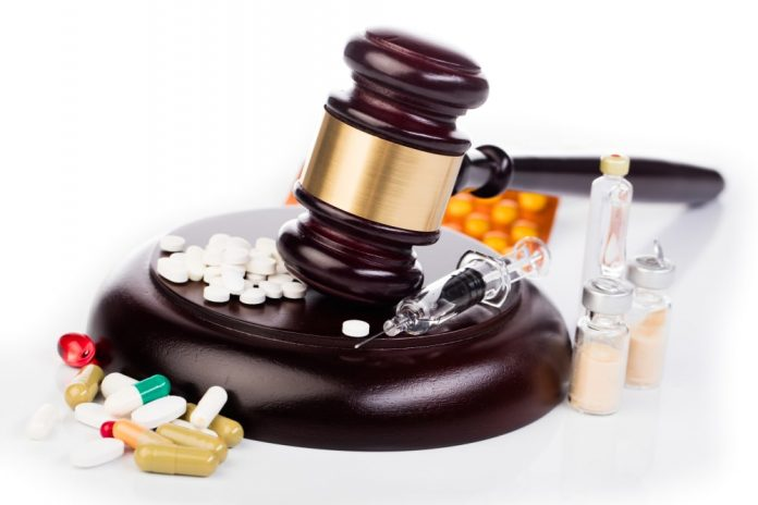 law gavel medicines and drugs isolated on white